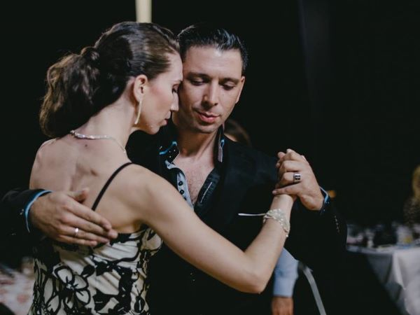 Chloe and Dionisis Theodoropoulos dancing at a tango event