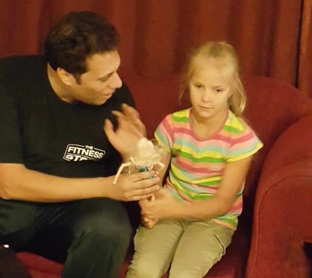 Helping Vica discover tango moves using dolls